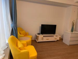 A television and/or entertainment centre at Gîtes Sax 2