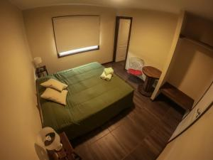 A bed or beds in a room at Folk Hostel