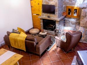Coin salon dans l'établissement Refúgio do Óscar