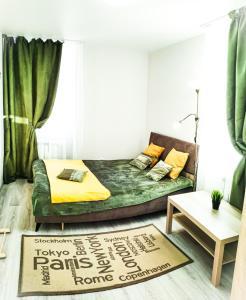 Кровать или кровати в номере Aliance smazchikov-Malevich