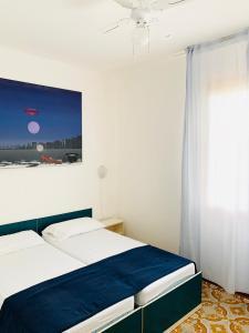 Postel nebo postele na pokoji v ubytování Villa Malta
