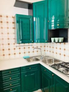 Kuchyň nebo kuchyňský kout v ubytování Villa Malta