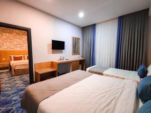 Cama ou camas em um quarto em Porto Hotel Baku