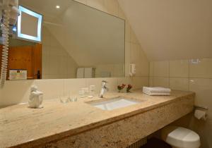 Ein Badezimmer in der Unterkunft Hotel Hofgut Sternen