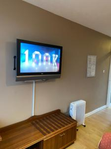 A television and/or entertainment center at west park hotel chalets