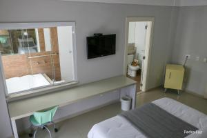 A bed or beds in a room at Hotel Terras da Finlândia