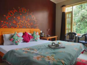 A bed or beds in a room at The Unmad, Dharamkot