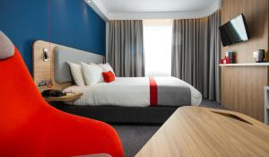 A bed or beds in a room at Holiday Inn Express Burton on Trent, an IHG Hotel
