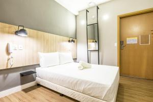 A bed or beds in a room at GRAAL INN ITATIAIA