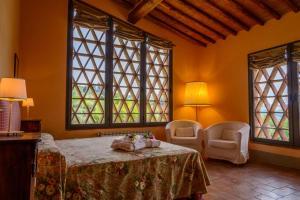 Кровать или кровати в номере Podere Vigliano
