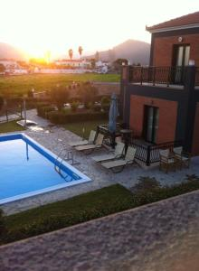 Πισίνα στο ή κοντά στο Kalloni Beach Villas