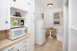 A kitchen or kitchenette at MarQueen Hotel