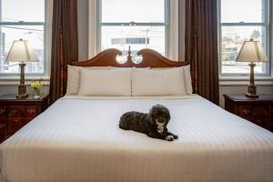 A bed or beds in a room at MarQueen Hotel