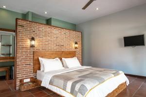 Ein Bett oder Betten in einem Zimmer der Unterkunft Belukar