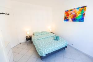A bed or beds in a room at Superbe 100m2 - 2 Balcons - Proche Gare - Climatisé