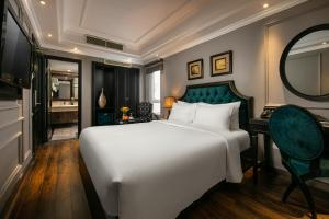 A bed or beds in a room at Scent Premium Hotel