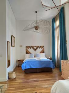 A bed or beds in a room at L'Adresse Hôtel Boutique