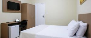 A bed or beds in a room at Hotel Mar do Farol