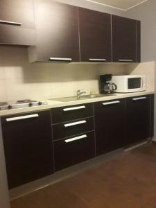 A kitchen or kitchenette at Hotel La Louve
