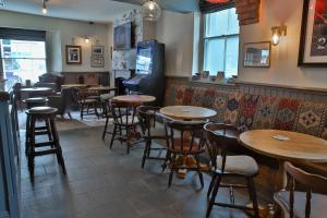 A restaurant or other place to eat at The Seale Arms
