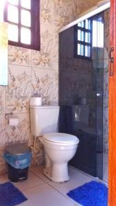 Um banheiro em Pousada Recantos dos Mineiros
