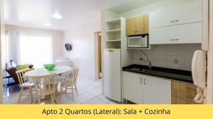 A kitchen or kitchenette at Residencial Dona Naime