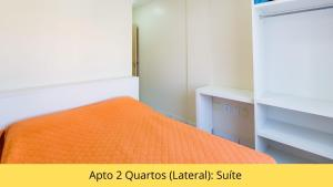 A bed or beds in a room at Residencial Dona Naime