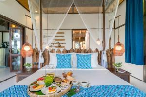 A bed or beds in a room at Koh Yao Yai Village - SHA Plus