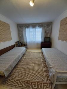 Кровать или кровати в номере Apartment on Lenina 55