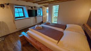 Posteľ alebo postele v izbe v ubytovaní Mária B