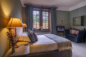 A bed or beds in a room at Swinton Park