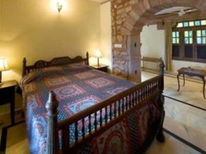 A bed or beds in a room at Chandelao Garh