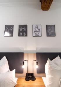 A bed or beds in a room at Le Baldinger Boutique Hotel