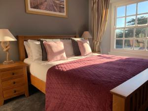 A bed or beds in a room at St Agnes Hotel