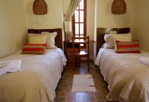 A bed or beds in a room at Terrace Lodge