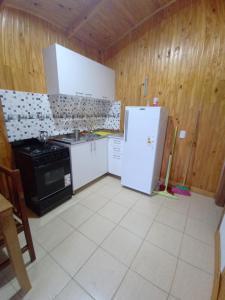 A kitchen or kitchenette at El Amanecer Hospedaje
