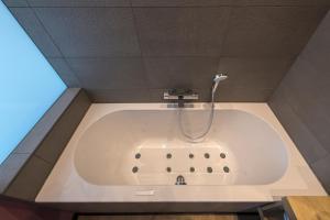 Een badkamer bij Palace Hotel Zandvoort