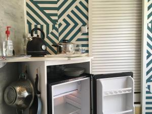 A cozinha ou cozinha compacta de Aloha Bungalow Moorea