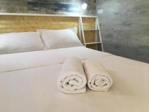 Cama ou camas em um quarto em Aloha Bungalow Moorea