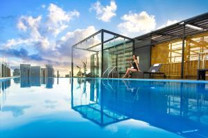 The swimming pool at or near Bay Hotel Ho Chi Minh