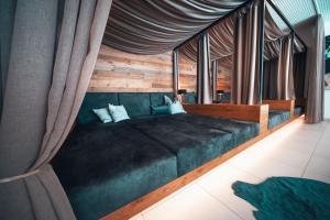 Postel nebo postele na pokoji v ubytování Sun Lodge Schladming by Schladming-Appartements