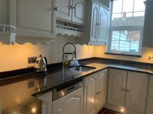 A kitchen or kitchenette at 5 Star, New, stunning, house in London with Garden - 8 miles to Central London