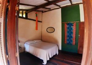A bed or beds in a room at Cabana Lua - praia de castelhanos