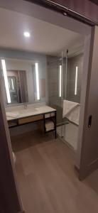A bathroom at Hilton Garden Inn Sudbury, Ontario, Canada