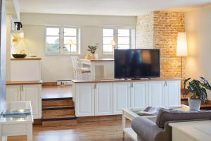 A television and/or entertainment center at Pierspeicher Boutique Hotel