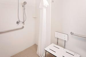 A bathroom at Homewood Suites by Hilton Dallas Market Center