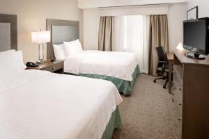 A bed or beds in a room at Homewood Suites by Hilton Dallas Market Center