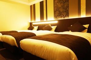 A bed or beds in a room at Lantana Osaka
