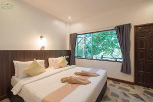 Voodi või voodid majutusasutuse Chai Chet Resort Koh Chang toas