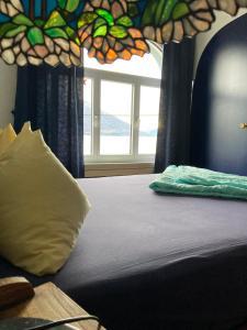 Кровать или кровати в номере BnB122 bed&breakfast